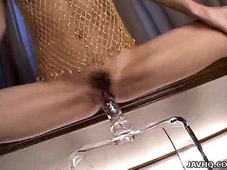 Japanese coddle playing with a big dildo uncensored